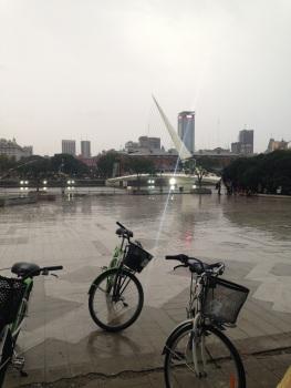 Pouring rain at Puente de la Mujer in Puerto Madero