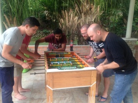 Playing foosball at the hotel