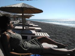 Relaxing on the black sand beach of Perivolos