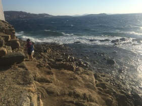 The winds in Mykonos are no joke - trying to get my hat after it blew into the sea