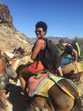 Riding donkeys up to Oia