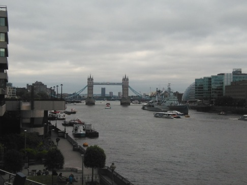 View of Tower Bridge and a cloudy Thames