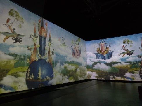 Bosch's art, animated on huge screens surrounding the room
