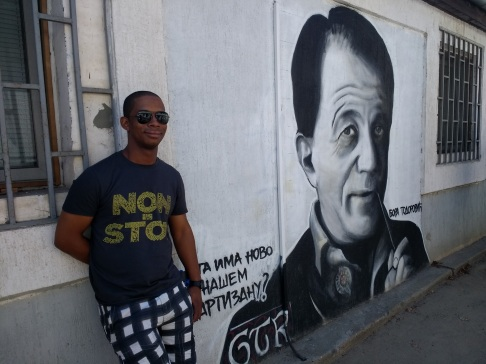 Sean in front of street art supporting Partizan, one of the two main football teams in Belgrade