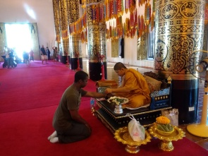 Getting blessed by a monk