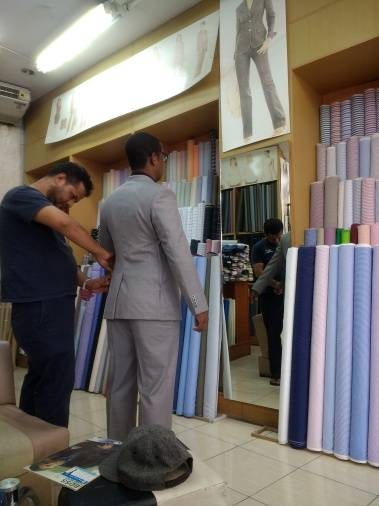 Sean getting fitted for a custom-made suit!