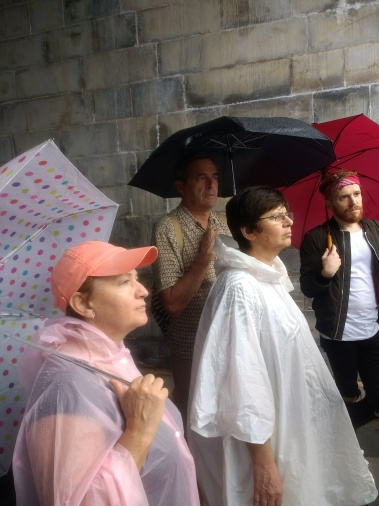 Listening to our tour guide, ponchos in tow