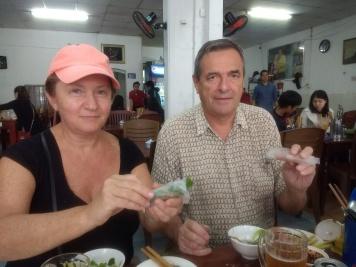 Parents making spring rolls at Hanh Restaurant